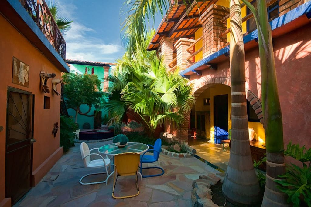 Our cool shady courtyard is an oasis with a private cantina at your fingertips just on the left.