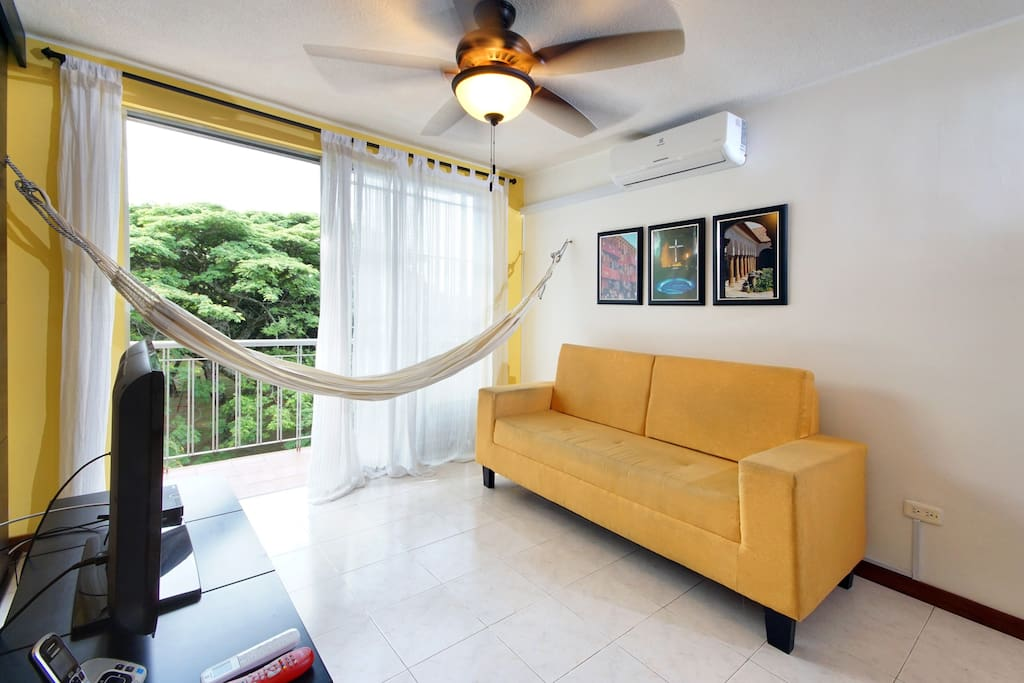 Living Room with Air Conditioning and Flat TV screen