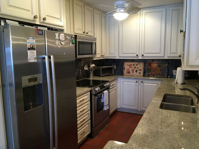 Newly updated kitchen with stainless steel appliances and granite countertops.