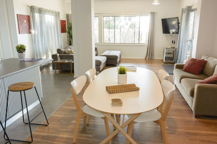 Spacious Dining, Lounge and TV area