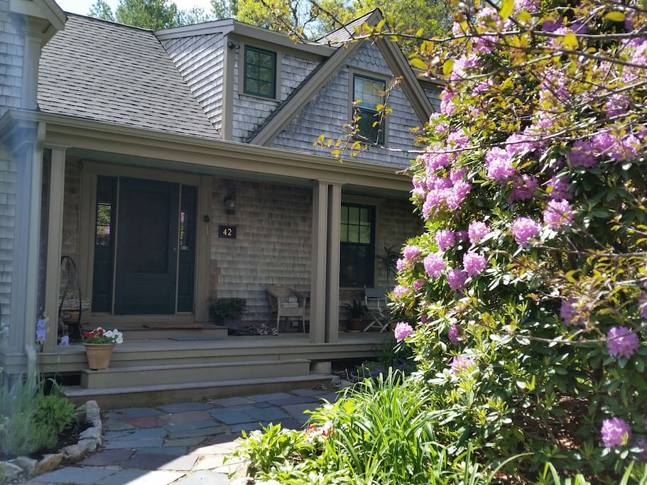 Front entrance and porch with perennial gardens.