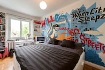 The kingsize bed in our son Williams room is big enough for three. The grafitti wall is made of Elias, one well known grafitti painter in Sweden.