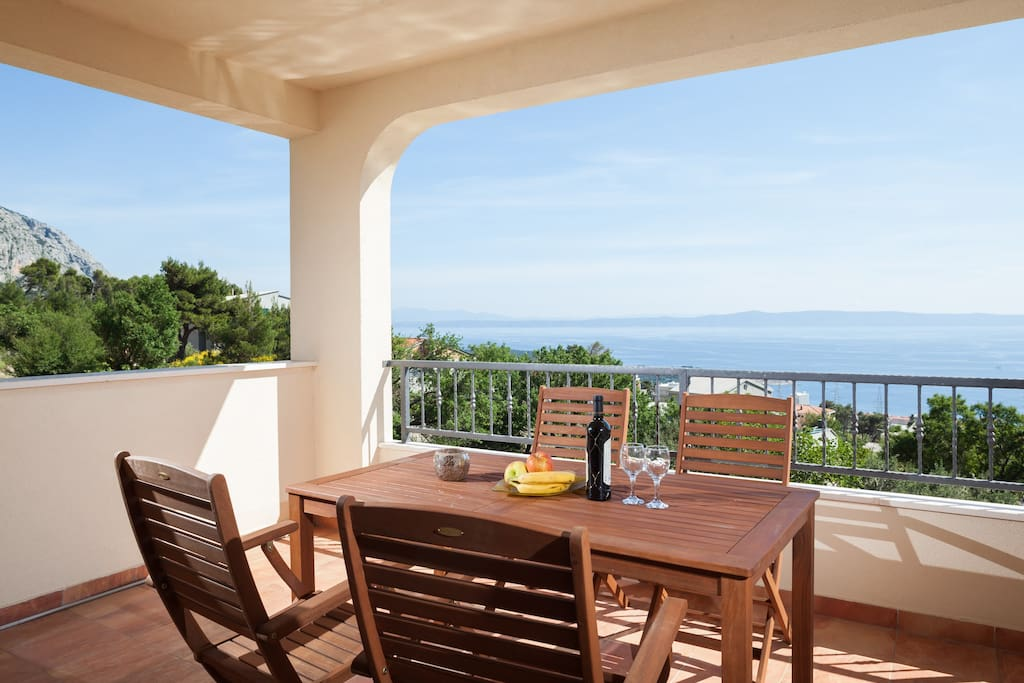 large balcony with the sea and mountain view