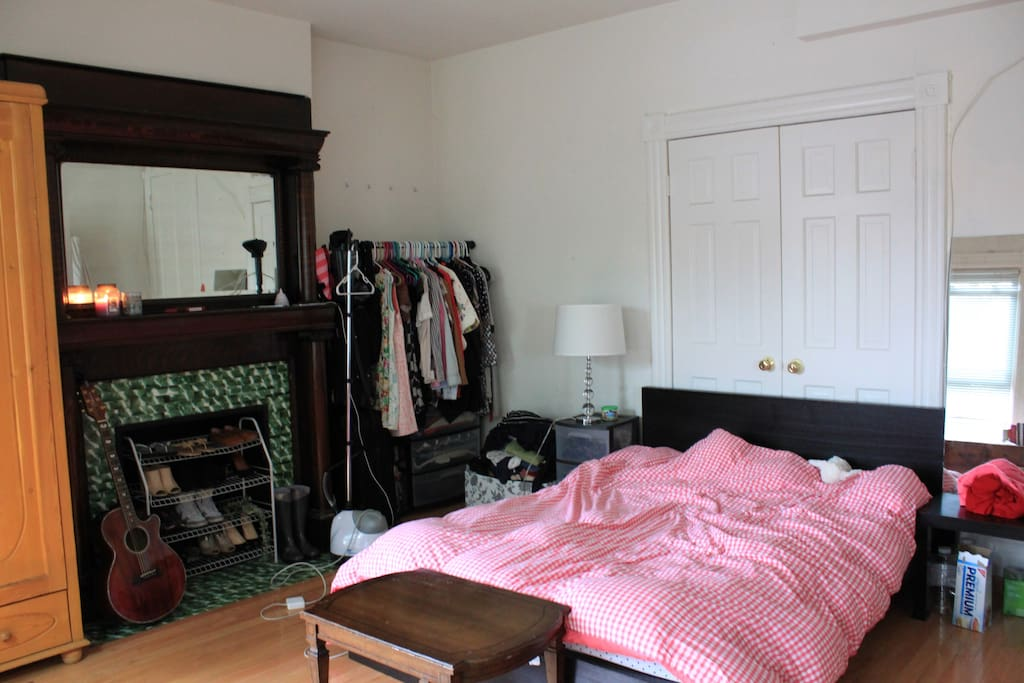 Indoor working fireplace, full-sized bed, and armoire.