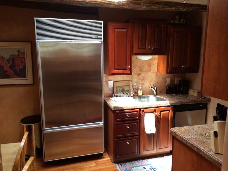 Full kitchen with Sub-Zero refrigerator.