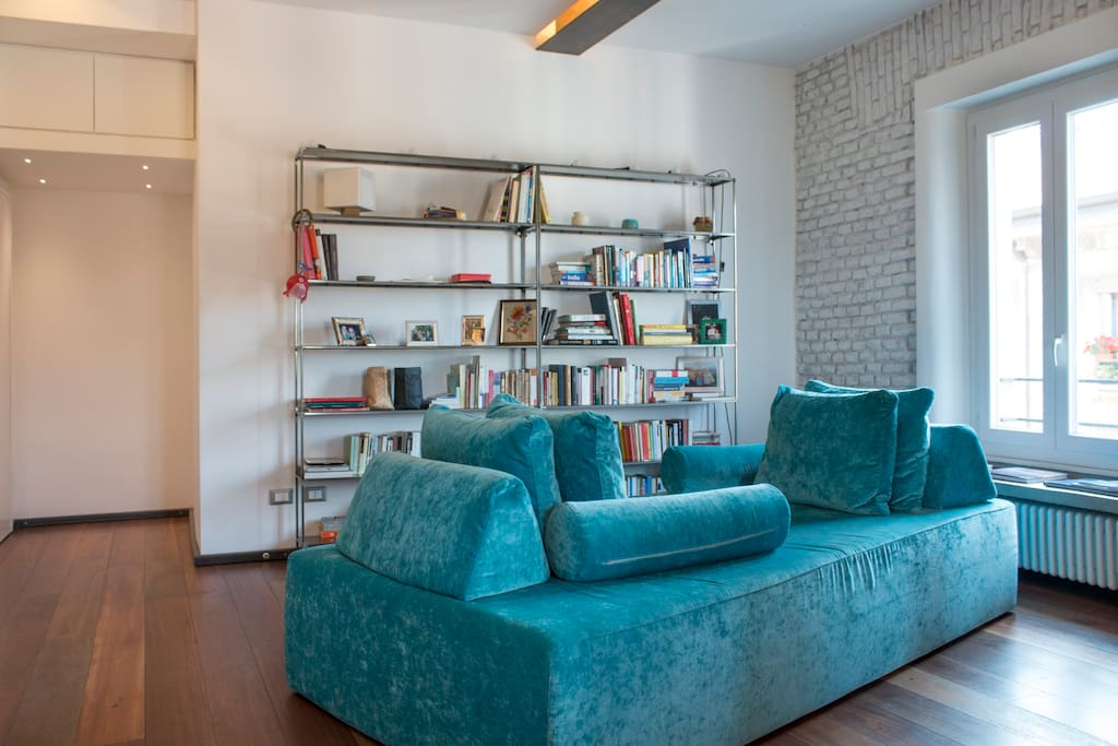 This blue couch is the signature of our loft. You will never want to leave it, so cosy!