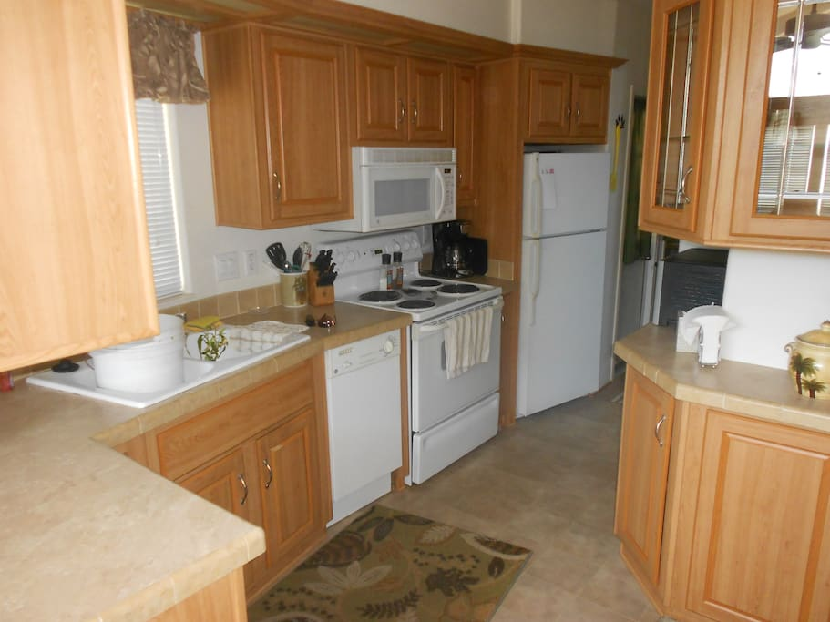 Full size kitchen with all large and small appliances, dishes, and cookware