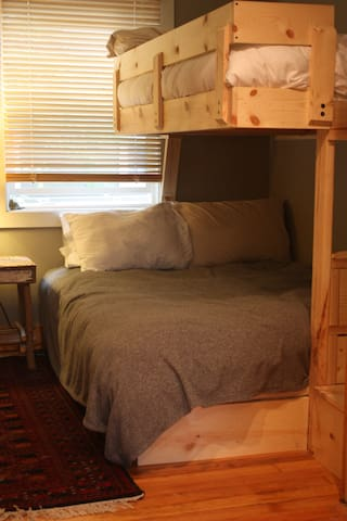 Bunk room with full on bottom, single on top
