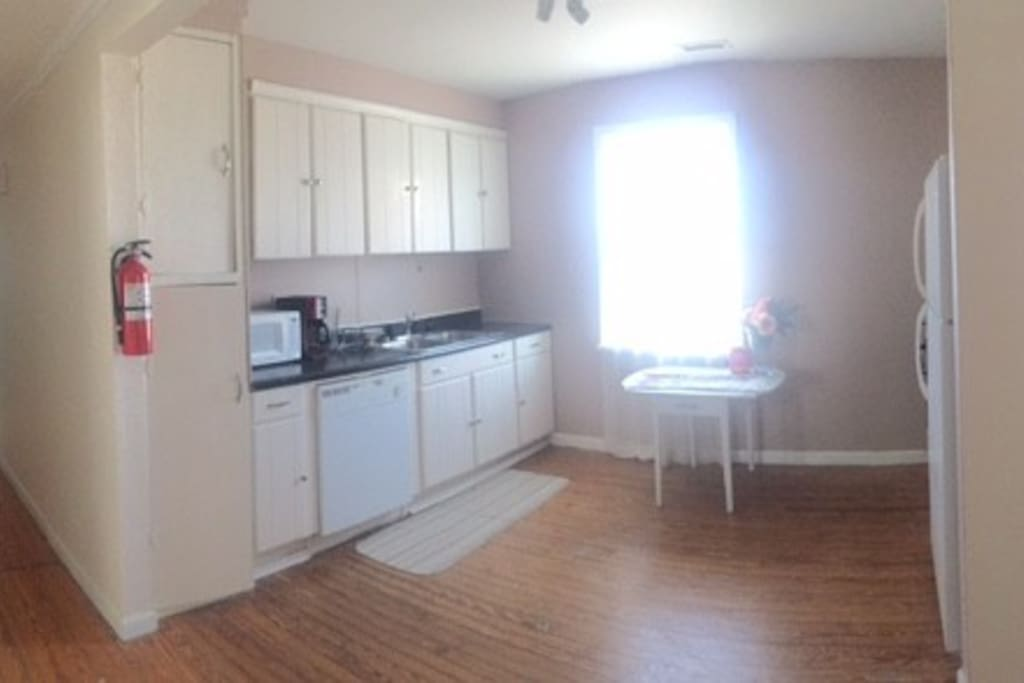 Full working kitchen with refrigerator, stove, microwave, dishwasher and coffee pot!