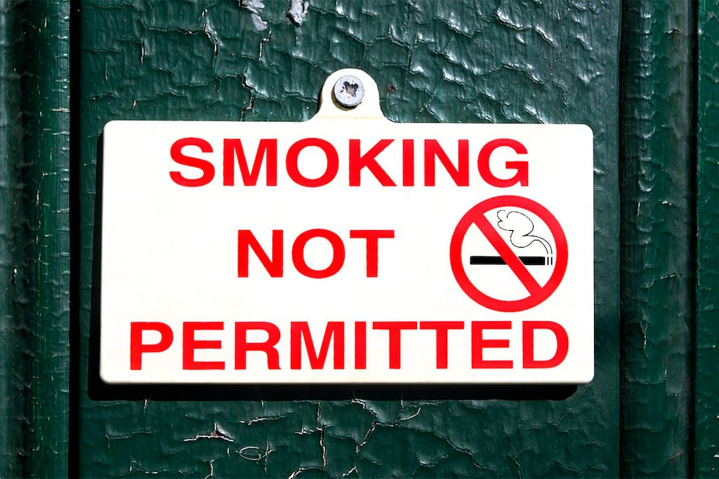 SMOKING IS NOT PERMITTED ANYWHERE, INDOORS OR OUTDOORS, ON THE PROPERTY - if you must smoke go outside to the street.