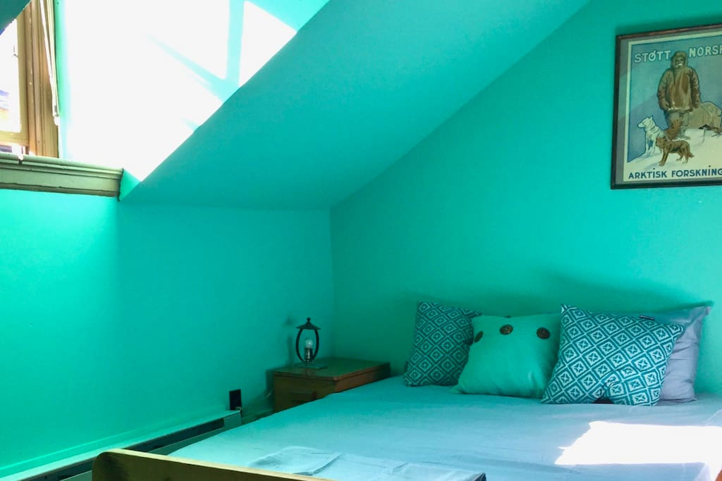 The Arctic Bedroom is drenched with soothing light and a queen sized bed for napping.