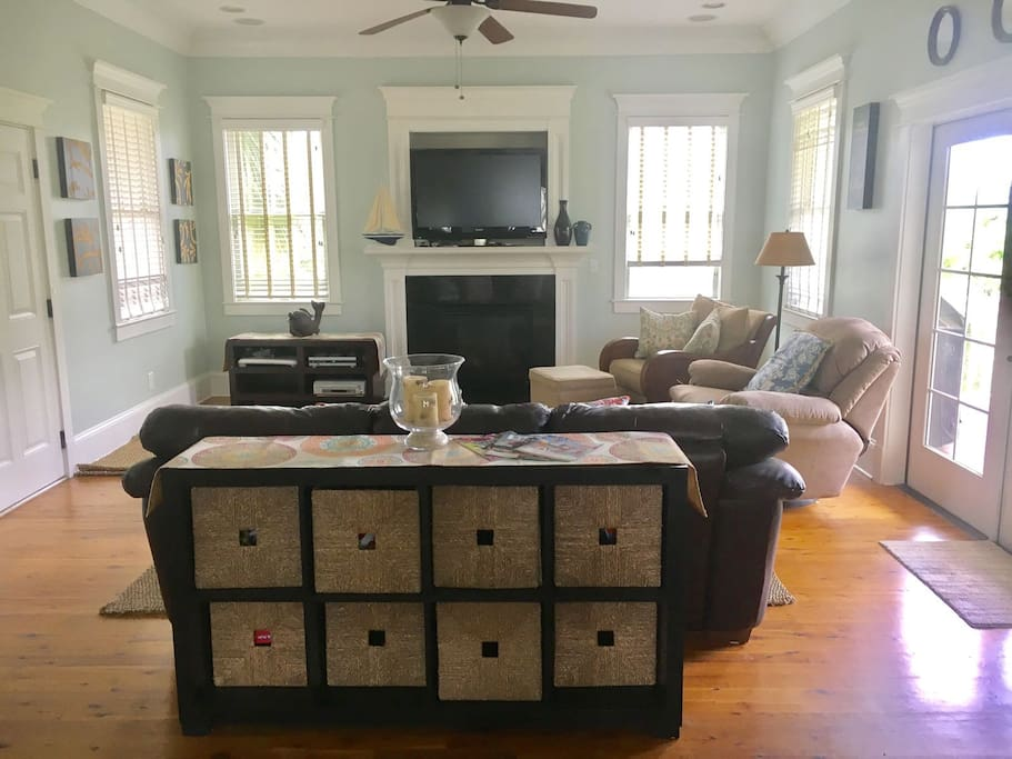 The open living area has plenty of conversational seating and a view of the TV.