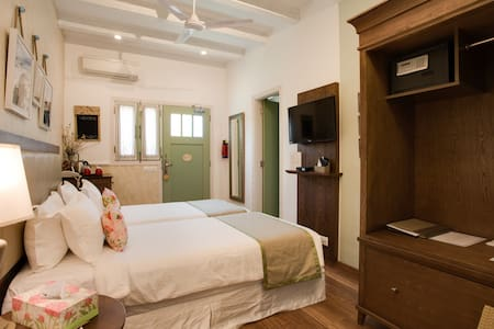 Private bedroom on ground floor with attached lounge and sitting area and kitchenette