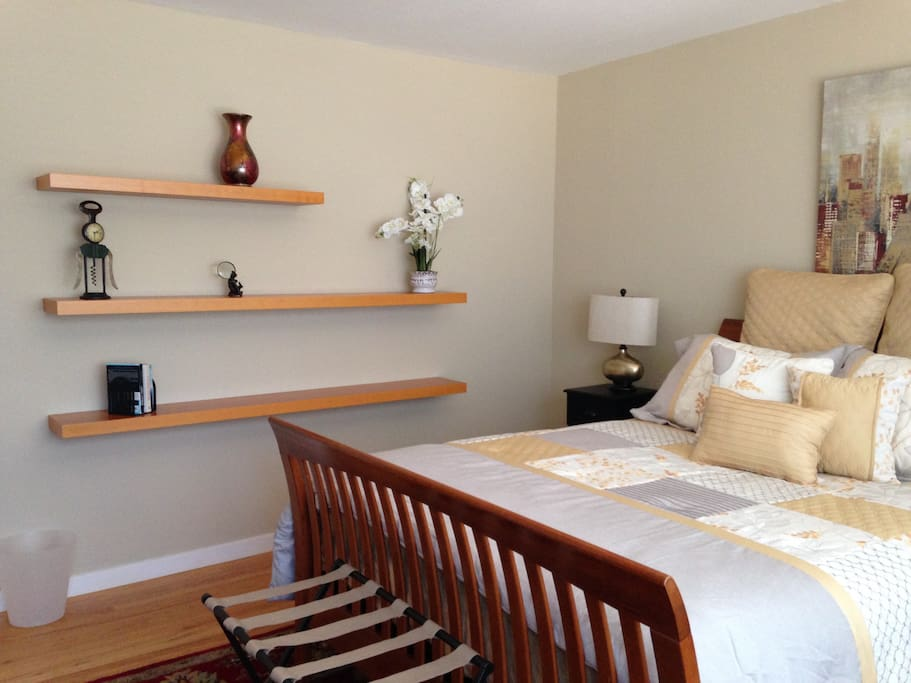 Wall shelving in master bedroom
