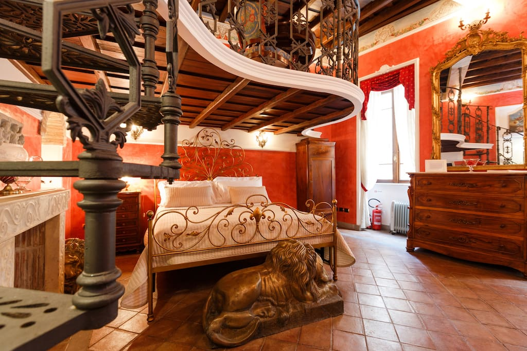 the elegant main room with the KING SIZE BED and antique forniture