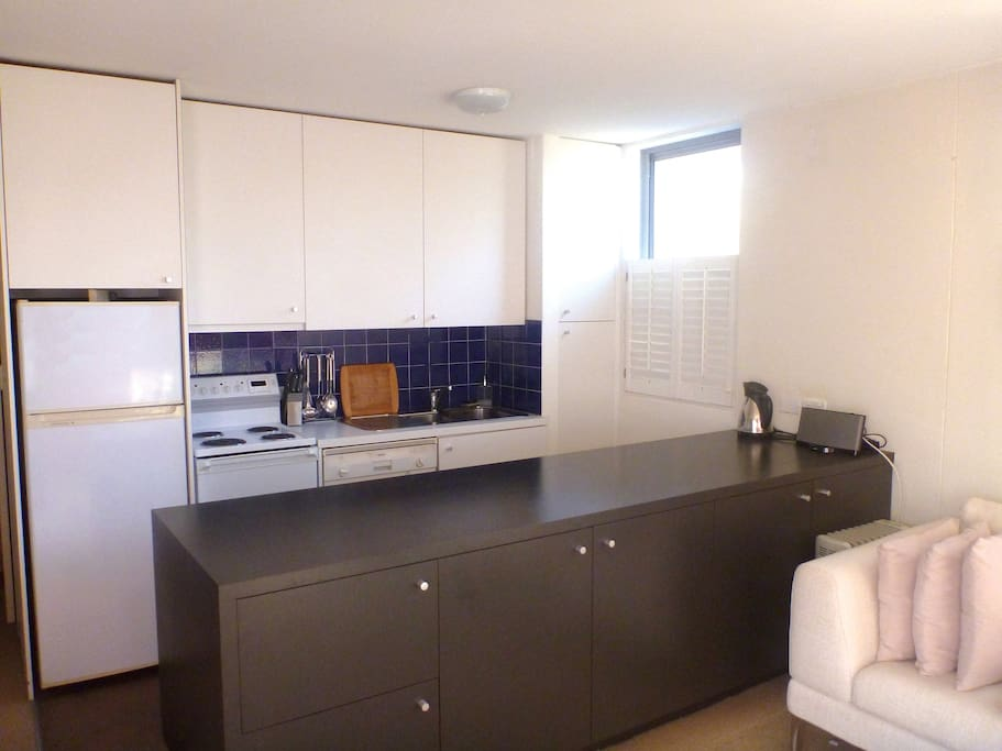 Open plan kitchen with dishwasher and microwave.