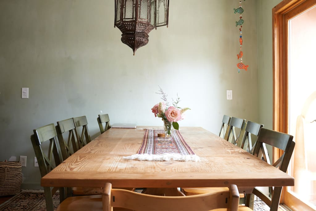 Farm style dining table can expand to seat 8-10 guest.