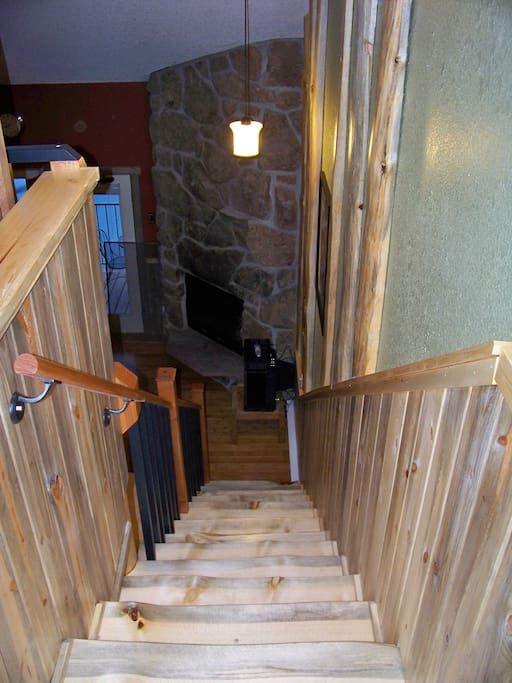 Natural pine staircase looking down
