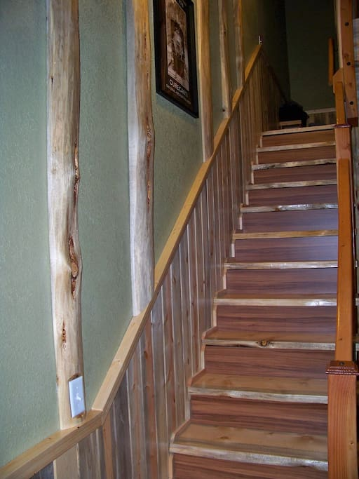Natural pine staircase looking up