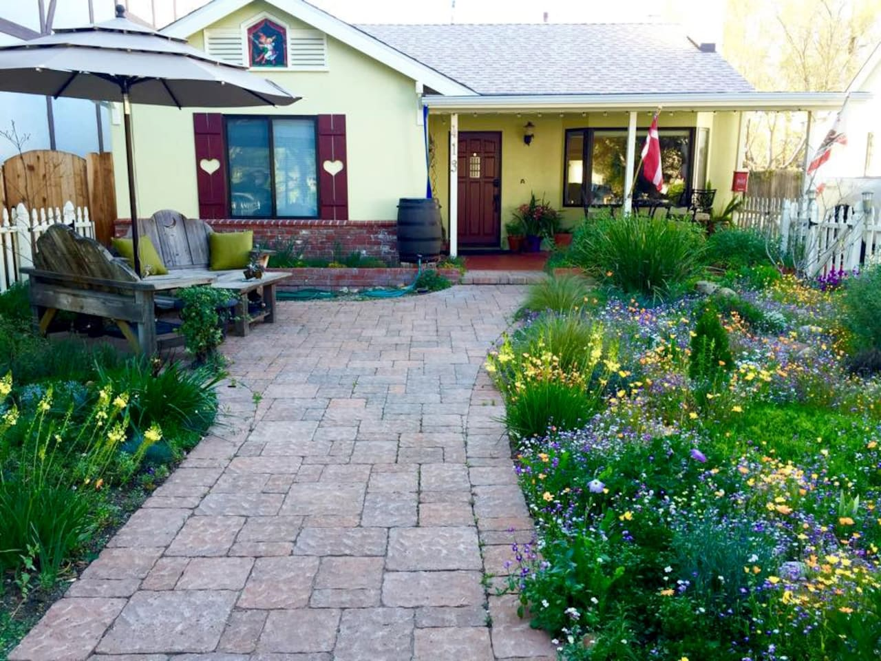 View of Great Dane Guest House front garden and house