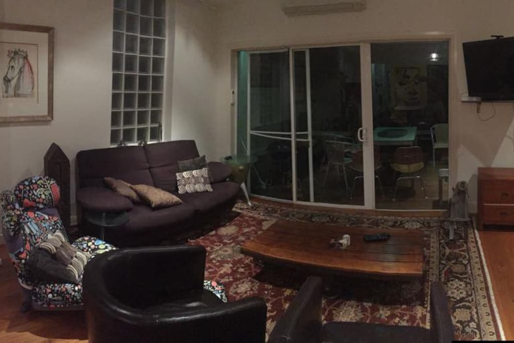 Living room. Entrance to terrace in background.