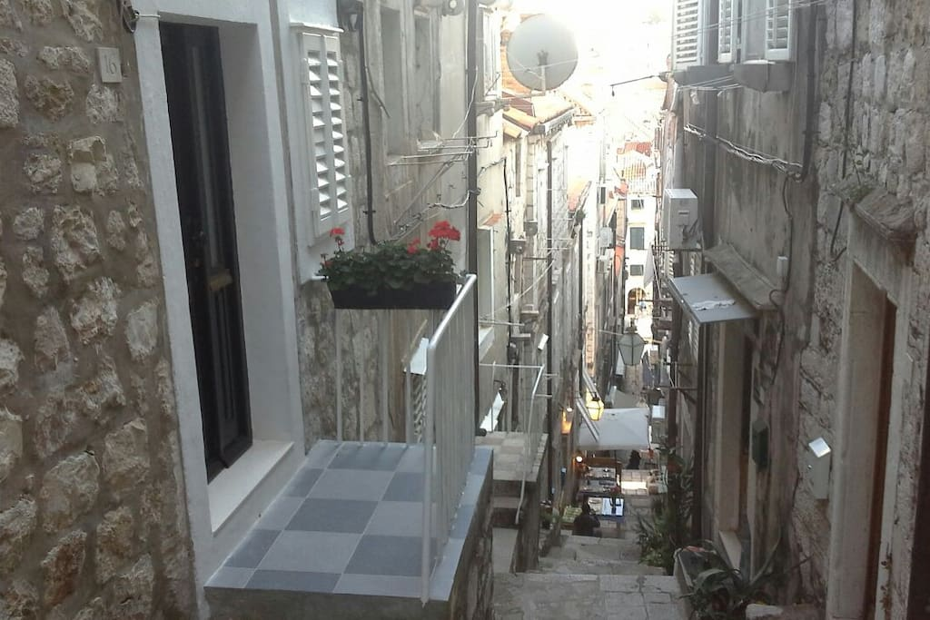 """The apartment, which is an entire house in 3 floors, was spacious, beautifully and practically arranged."""" Tunc Stairs leading down to the main promenade Stradun"""