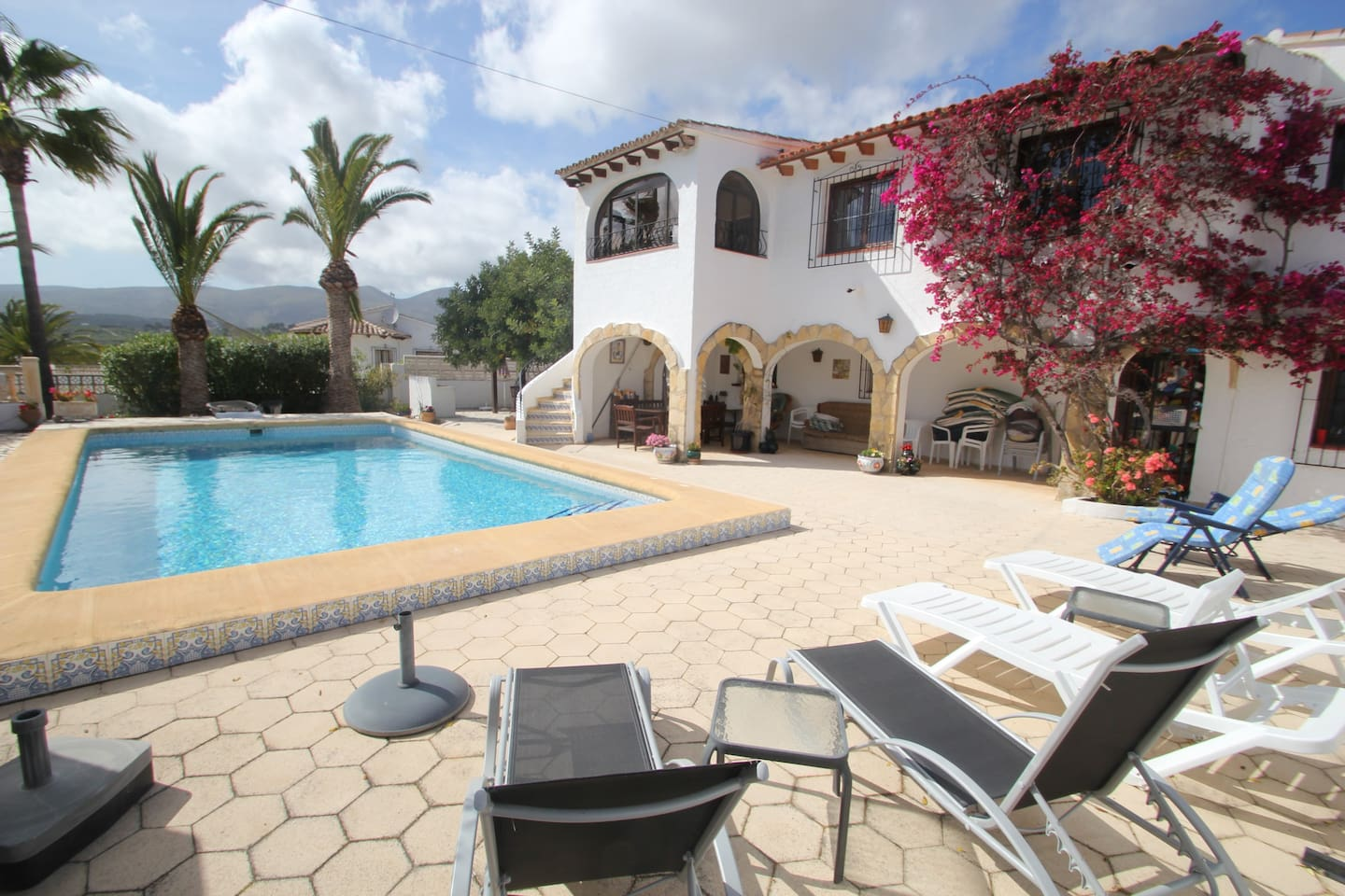 View of the front of villa looking across the full size pool towards the Jalon valley and the Burnia mountain range