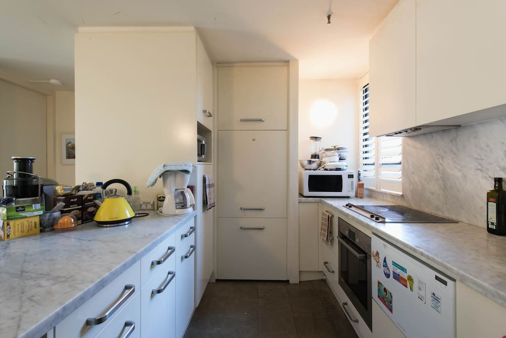 Fully Stocked Modern Style Kitchen with touch Oven technology, Dishwasher and Microwave