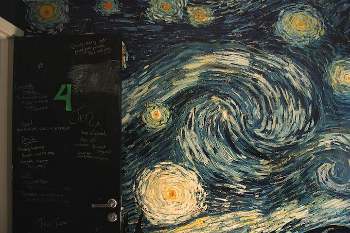 Van Gogh's 'Starry Night' adorn one whole wall in the room