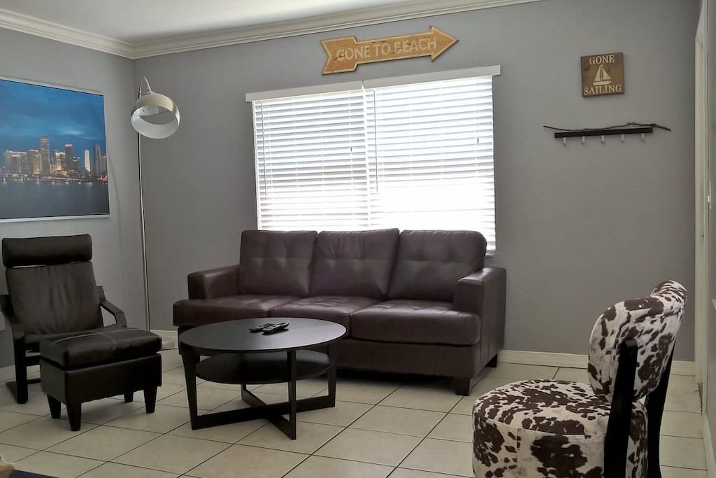 Spacious living room. Queen sized sofa bed, comfortable chairs, and ottoman.