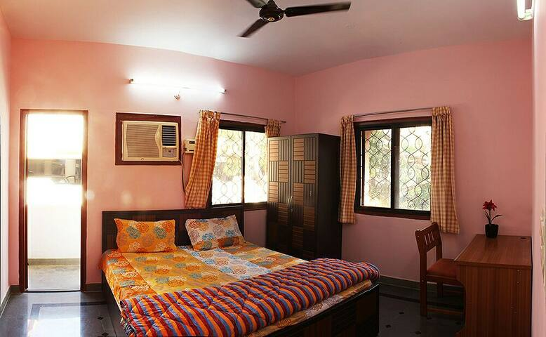 Bedroom 2 - Double -bed, Laptop working table, Wardrobe, curtains and a small balcony are the facilities.