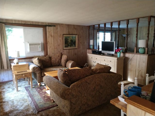 The living room has deep comfortable love seats, a coffee table/poker table and a dresser with games and movies inside.  There is Direct TV for your enjoyment.