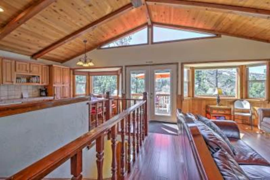 Spacious open floor plan living room and kitchen leads out to deck with views.