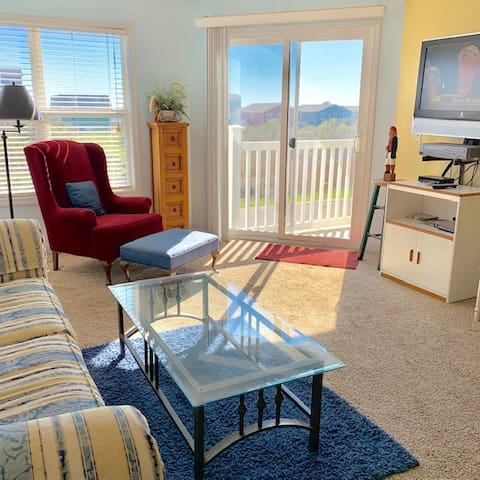 Living room with large TV/Cable.  Door to deck.