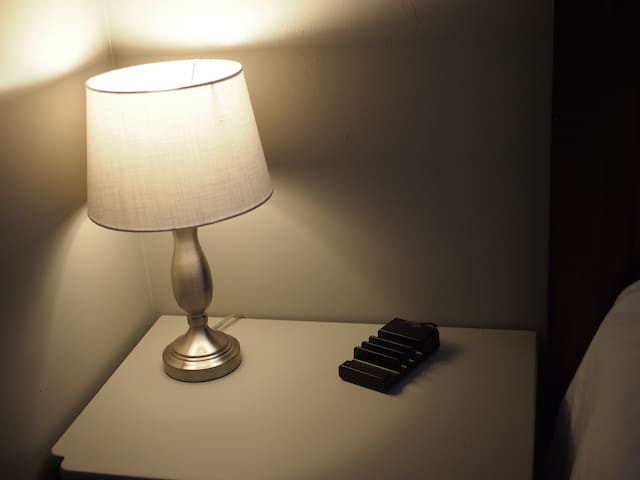 charging station  on the bedside table in the gray room