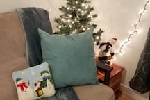 We're keeping it cozy in here all winter long. No matter what you celebrate, enjoy sitting in this festive corner as you watch the snow fall out the window and enjoy a cup of cocoa or coffee on us!