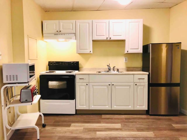 Newly renovated kitchen in January 2020 - new cabinets, countertop, sink and floor!