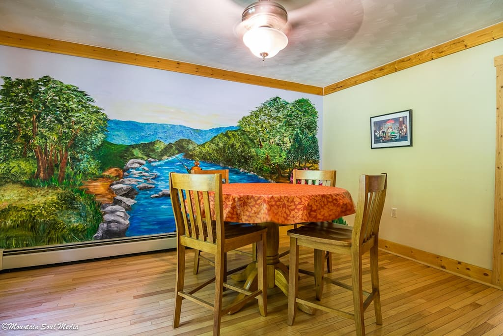 Game table and mural in the Rainbow Chalet