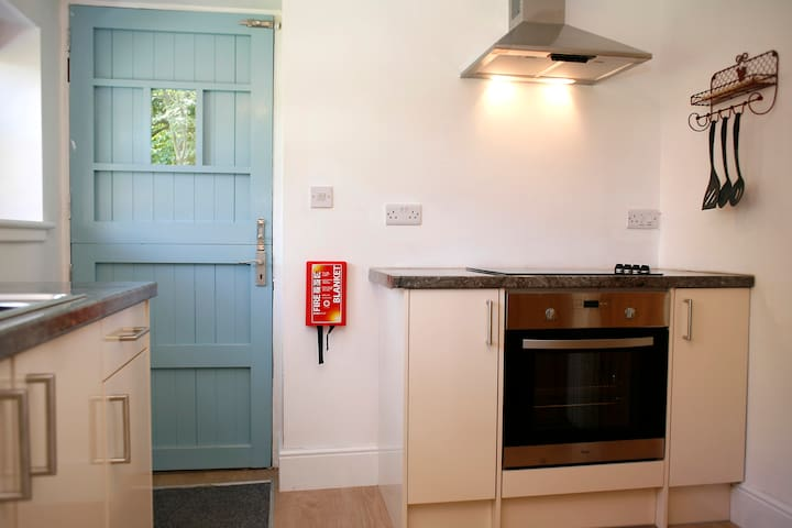 Kitchen equipped with proper oven, hob and microwave to cater for all cooking needs