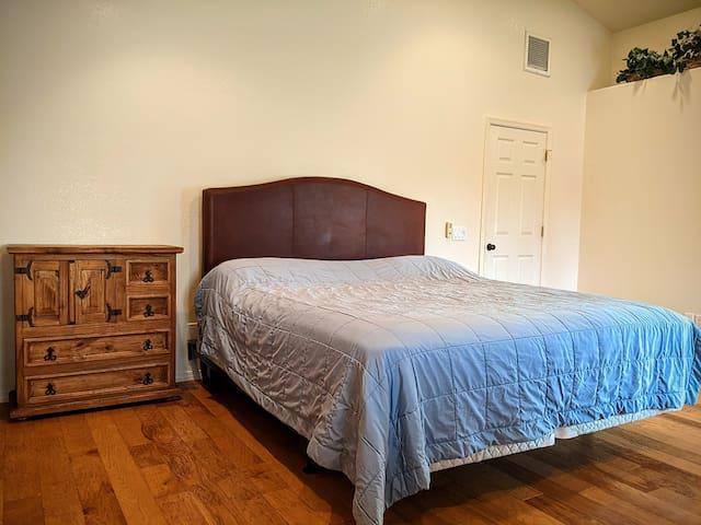 "Bedroom 4 (master), king bed, 32"" Samsung Smart TV in armoire"
