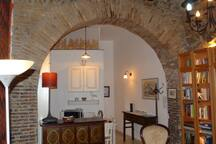 Kitchen area as seen through the arch.