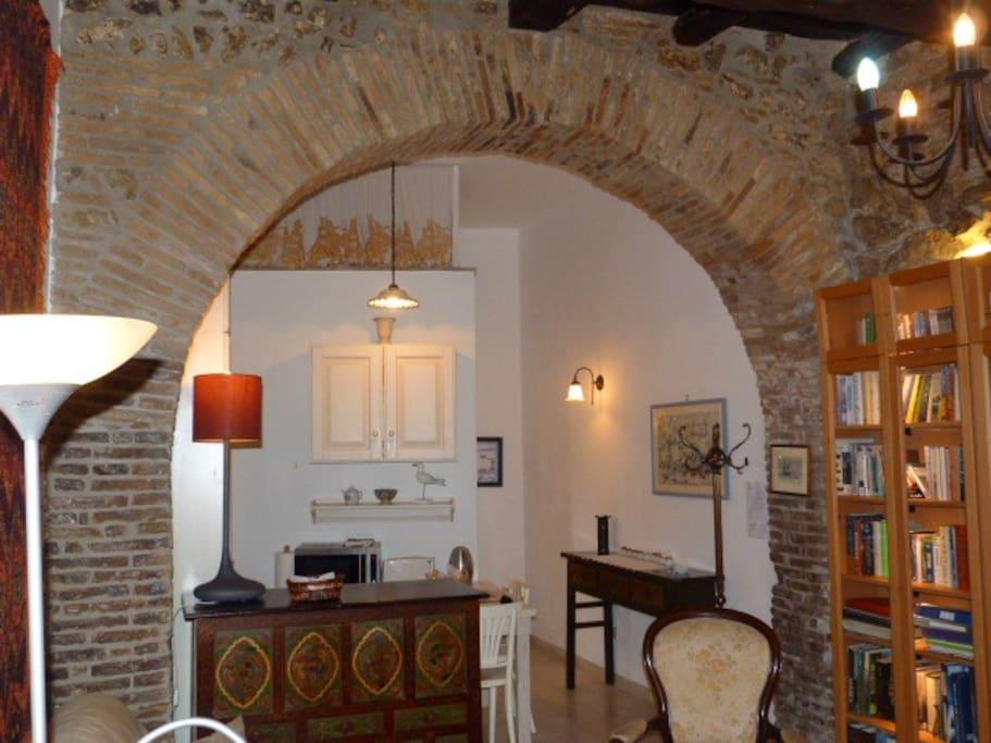 Kitchen area as seen through the same arch.