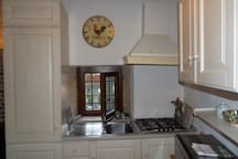 Italian design kitchen with full-sized frig-freezer.