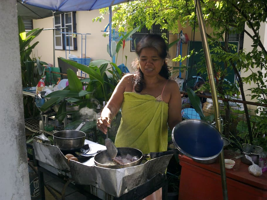 Mother cooking amazing home made  Thai cuisine