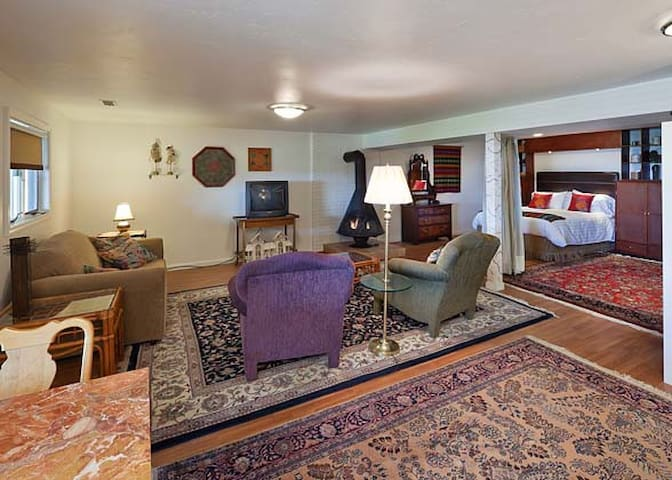 Patio suite includes large sitting area and walk-out garden level entrance.
