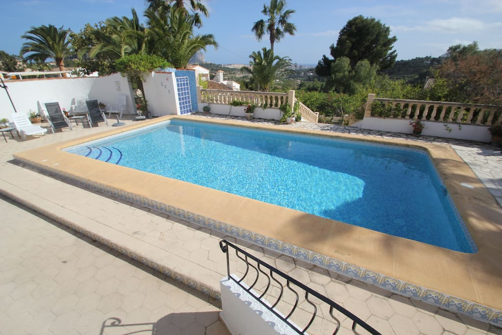 Full size swimming pool and hot outdoor shower with view of the ocean, the Penon d'Ifach, the port and Calpe town.