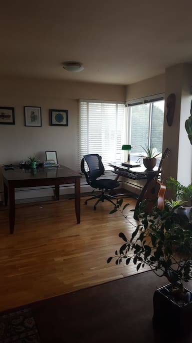 Hardwood floors w/ a desk.