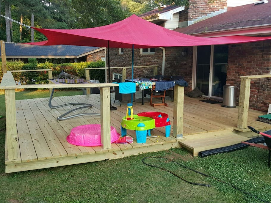 500 Sqf great sun deck with dinner table, chairs, BBQ and hammock