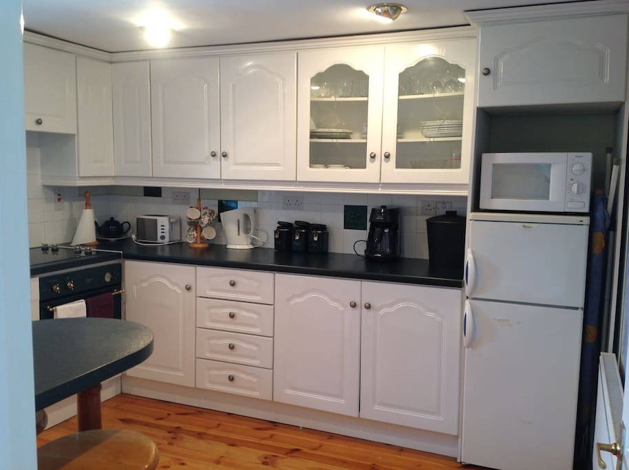Modern kitchen, complete with washing machine,cooker,hob,microwave,dishwasher and all essentials needed for your stay