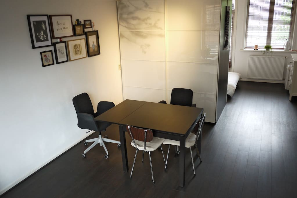 Dining/working area with extendable table top.
